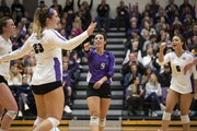Ellie Meyer, center, in a MIAC championship game, was an All-America team member in volleyball and nominated by the MIAC for NCAA Woman of the Year. �