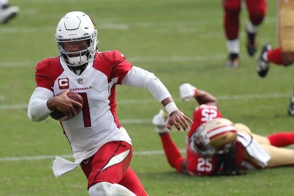 Cardinals quarterback Kyler Murray made for an elusive target, running past 49ers cornerback Richard Sherman to score a touchdown during the second ha