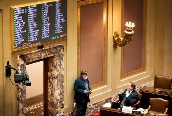 Sen. John Hoffman, DFL-Champlin, and Sen. Jim Abeler, R-Anoka, talked on the Senate floor during the third special session in August.