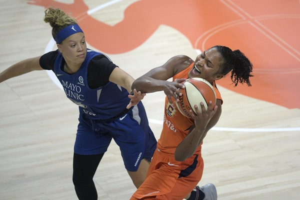 Guard Rachel Banham (left, shown in a July game against Connecticut) helped the Lynx (14-8) secure the No. 4 seed in the WNBA playoffs and the single