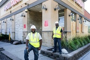 Lester Royal and Calvin Littlejohn, CEO of Tri-Construction, in north Minneapolis, where the firm is rebuilding a Family Dollar destroyed by riots.