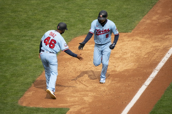Twins third base coach Tony Diaz greeted Marwin Gonzalez after his two-run homer in the third inning Sunday.