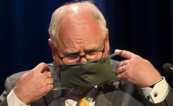 Minnesota Gov. Tim Walz put his face mask at the conclusion of a press conference in July announcing the learning plan for Minnesota schools for the u