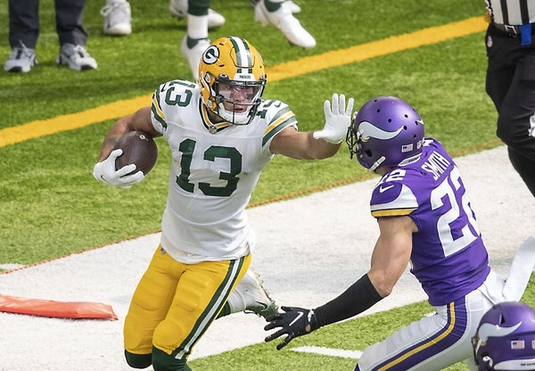 Green Bay Packers wide receiver Allen Lazard stiff armed Minnesota Vikings free safety Harrison Smith during the first quarter as the Vikings took on