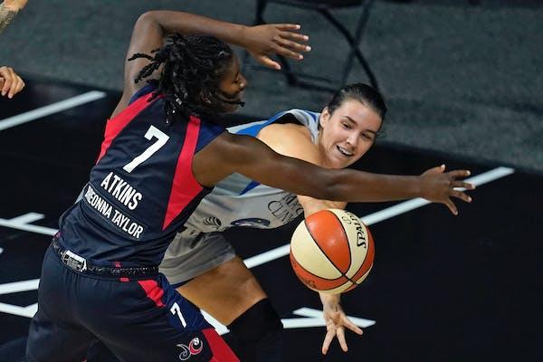 Lynx guard Bridget Carleton moves the ball around Washington Mystics guard Ariel Atkins on Sept. 8