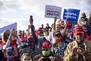 Trump supporters craned their necks as they tried to get a look at the runway in Bemidji on Friday as they awaited the president's arrival.