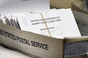 In this June 30, 2020, photo, a box of absentee ballots wait to be counted at the Albany County Board of Elections in Albany, N.Y.