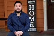 Rep. Fue Lee (DFL) District: 59, seen outside his Northside home Wednesday in Minneapolis, said 20 members of his family came down with COVID-19 after