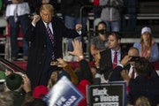 """President Trump danced down the catwalk to """"YMCA"""" Friday night in Bemidji as his supporters cheered him on after his speech there."""