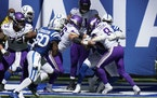Vikings quarterback Kirk Cousins is sacked by Indianapolis Colts' DeForest Buckner (99) for a safety