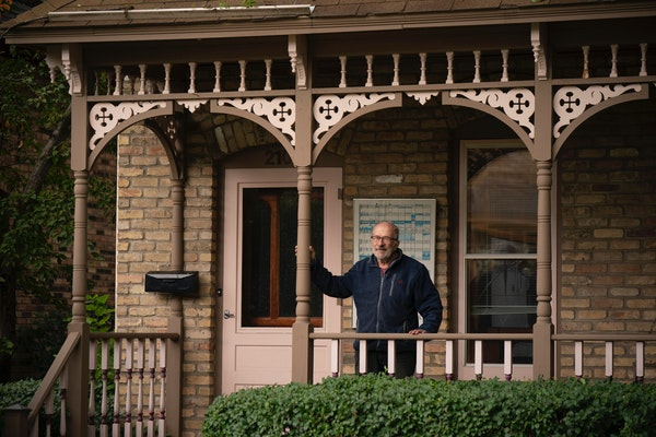 Bob Roscoe on the porch of his former house on Milwaukee Avenue in south Minneapolis.