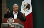Mexico's President Andres Manuel Lopez Obrador addresses family members of 43 missing students from the Rural Normal School of Ayotzinapa, during a