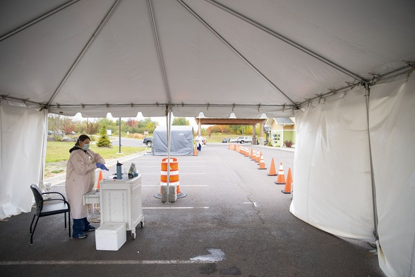 Cheryl Odegaard, a medical assistant at St. Luke's Respiratory Clinic, prepared to administer COVID-19 tests to patients in their drive-through test