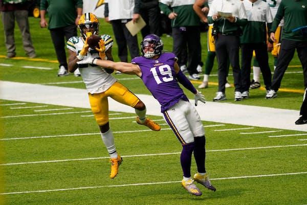 Packers cornerback Jaire Alexander intercepts a pass intended for Adam Thielen during Week 1.