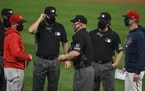 Reds manager David Bell, brother to Twins bench coach Mike Bell, spoke to umpires and exchanged lineup cards before the first pitch of a game in Septe