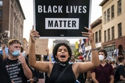 Protesters marched downtown to the Minneapolis Police Department's First Precinct on Aug. 24.