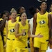 The Seattle Storm celebrate after the team defeated the Minnesota Lynx during Game 3 of a WNBA basketball semifinal round playoff series Sunday, Sept.