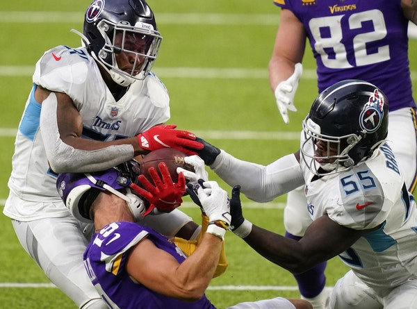 Tennessee inside linebacker Jayon Brown (55) and free safety Kevin Byard (31) batted away a pass meant for Vikings receiver Adam Thielen in the fourth
