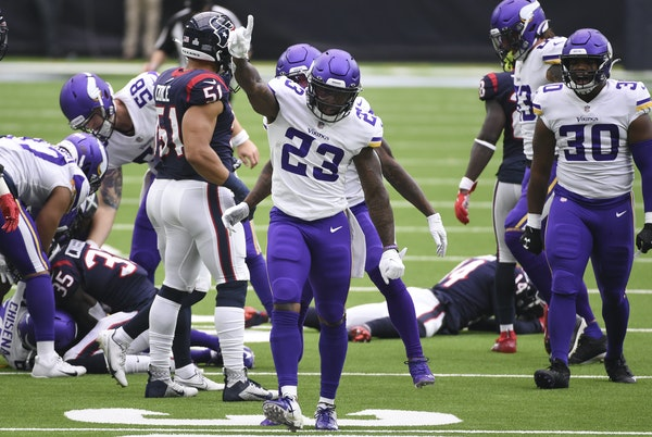 Running backs Mike Boone (23) and C.J. Ham (30) were jubilant after a special-teams trip on which a Boone hit forced a Texans fumble, leading to a fie