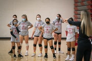 North St. Paul coach Stephanie Blanda led a workout during the first day of volleyball tryouts on Sept. 28 at the school.