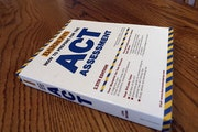 An ACT exam preparation book is seen in Springfield, Ill., in this photo from April 2014.