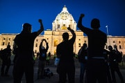 Families of those killed by police marched with hundreds of supporters to the Capitol in St. Paul on Thursday night.