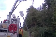 A MnDOT maintenance worker removes the Do Not Spray sign from the ditch abutting David Weissing's land.