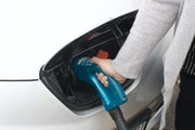 A driver removes the Fast Charger after charging her Nissan Leaf, an electric car, at a BP off Lyndale Avenue S.