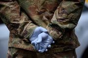 A Minnesota National Guardsman wore medical gloves to a free testing event at the Minneapolis Armory in May.