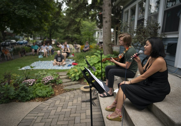 Hope Nordquist and Kai Brewster performed from the front steps of the McHenry house in August.