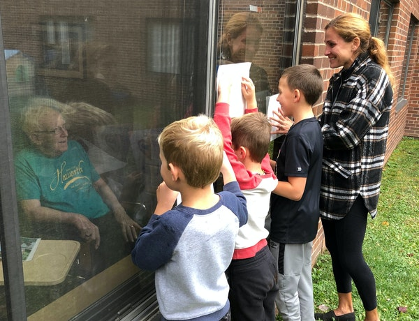 Kara Goucher, right, with son Colt, 10, and nephews Luka and Lachlan Grgas visited her grandfather Calvin Haworth at the hospital as he battled COVID-