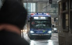 Riders awaited the C-Line Rapid Transit bus on 7th Street in downtown Minneapolis in October.