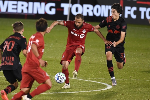Red Bulls' Caden Clark, right, pressures Toronto FC's Nick DeLeon, left, during the second half of an MLS soccer match Wednesday in East Hartford, Con