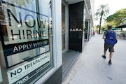 """A Zara store posted a large """"Now Hiring,"""" sign in its window in Miami Beach, Fla."""