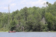 Anglers fish on Birch Lake in July 2019 near the shoreline where mine buildings would be erected should the Twin Metals project happen.
