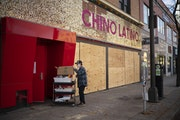A worker removed supplies from Hennepin Avenue's Chino Latino, which closed this week after a 20-year run.