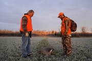Travis Pennings and his uncle Dan Pennings stopped to look over a deer Travis shot in 2018.