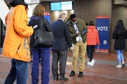 Voters checked in to vote at the Hennepin County Government Center, Oct. 27, 2020.