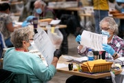 Ramsey County election judges Nancy Matthews and Kathy Lair checked ballots as they removed them from ballot envelopes.