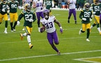 Minnesota Vikings running back Dalvin Cook (33) ran the ball in for a touchdown in the first quarter against Green Bay.