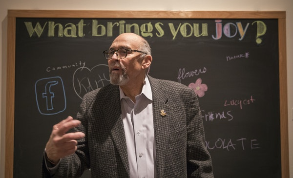 """Penumbra founder Lou Bellamy toured the """"Penumbra Theatre at 40"""" exhibit at the Minnesota History Center in 2017."""