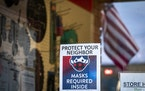 A sign outside the True Value hardware store in downtown Spring Grove reminded people to wear masks.