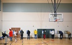 Voters filled out their ballots at Lucy Laney at Cleveland Park Community School in north Minneapolis Tuesday, Nov. 3, 2020.