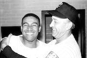 July 4, 1961: Manager Sam Mele hugs Julio Becquer