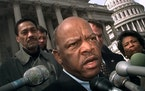 FILE - In this Friday, March 5, 1999, file photo, U.S. Rep. John Lewis, D-Ga., speaks with reporters in Washington. Officials in Nashville have rename