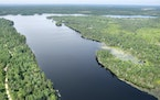 An aerial view of Birch Lake near the Boundary Waters Canoe Area Wilderness, showing the land that would become an underground mine (left) and additio