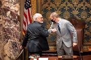 Outgoing Senate President Senate President Jeremy Miller, R-Winona, right, gave Sen. David Tomassoni, DFL-Chisholm, a congratulatory elbow bump before
