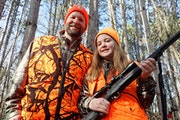 Zeb McInerny with his 13-year-old daughter, Ella, on Friday afternoon outside their home in rural Rockford. The family won a hunting license lottery f