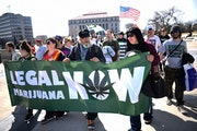 In this 2018 photo, pro-legalization advocates marched from Christ Lutheran Church to the Minnesota State Capitol during Cannabis Awareness Day. AARON