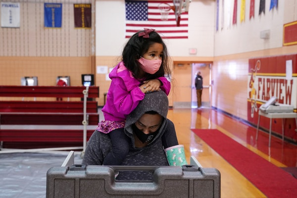Elliana Mulari, 3, sat atop dad Timothy's shoulders as he voted at Fairview Park Recreation Center in north Minneapolis on Election Day.